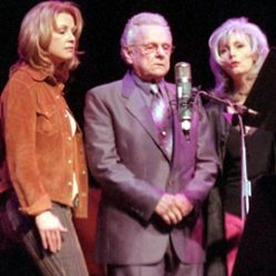 Patty Loveless, Ralph Stanley, and Emmylou Harris performing at L.A.'s Universal Amphitheatre in 2002.